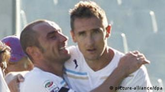 Lazio's German striker Miroslav Klose, right, celebrates after scoring the winning goal during a Serie A soccer match between Fiorentina and Lazio at the Artemio Franchi stadium in Florence, Italy Sunday, Oct. 2, 2011. Lazio won 2-1.