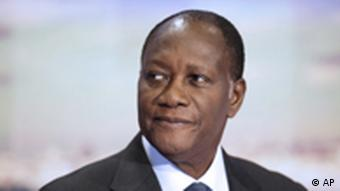Ivory Coast President Alassane Ouattara poses on the TV set of French channel TF1 prior to an interview that was part of the evening news broadcast, Tuesday Sept. 13, 2011 in Paris. (AP Photo/Fred Dufour, Pool)