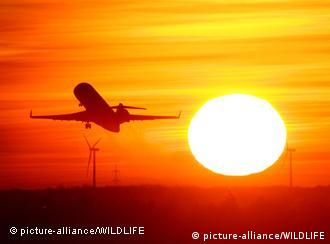 Airplane take-off at sunset