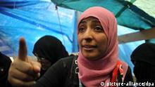 epa02956263 Yemeni women's rights and democracy campaigner Tawakkul Karman, 32, one of the three recipients of the 2011 Nobel Peace Prize, reacts as she receives congratulations from protesters inside her tent at a protester camp in Sana_a, Yemen, 08 October 2011. According to media reports, the Yemeni opposition called for more demonstrations across the country to honour Yemeni Nobel Peace Prize winner Tawakkul Karman, one day after she was awarded the Prize along with Liberian President Ellen Johnson Sirleaf and Liberian women's rights activist Leymah Gbowee for their non-violent struggle for the safety of women and for women's rights to full participation in peace-building work. EPA/YAHYA ARHAB