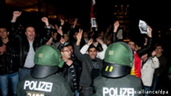 German police confront Syrian protesters in Berlin
