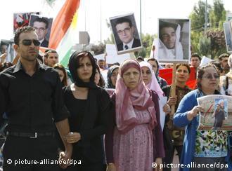 Faris (L), the son of the killed Syrian Kurdish opposition leader Meshaal Tamo