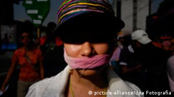 An image of a woman tied with a gag