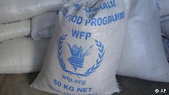In this photo of Monday, Aug. 8, 2011 sacks of World Food Program, WFP, food is seen on a truck before being dropped off for storage in warehouses in the former Somali water agency that runs the biggest sell off of food aid in Mogadishu. An Associated Press investigation in Somalia has found that thousands of sacks food aid are being stolen and sold on the black market, undermining the international response to the country's crippling famine. Sacks of food stamped with emblems from the World Food Program, the U.S. government aid arm USAID and the Japanese government are for sale in Mogadishu markets. (AP Photo)
