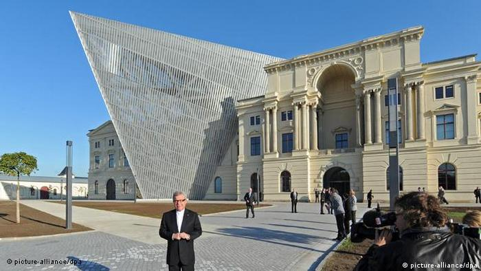 The front of the Military History Museum in Dresden, Libeskind stands outside of it.