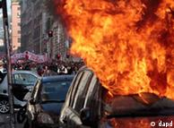 A car is set on fire as protesters clash with police in Rome, Saturday, Oct. 15, 2011. Protesters in Rome smashed shop windows and torched cars as violence broke out during a demonstration in the Italian capital, part of worldwide protests against corporate greed and austerity measures. The