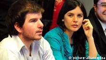 epa02952149 (L-R) Chilean students leaders Giorgio Jackson, Camila Vallejo and other teachers' and students' heads speak during a meeting with Education Minister, Felipe Bulnes, aiming to negotiate the free education in the country at the Education Ministery head quarters in Santiago de Chile, Chile, 05 October 2011. Students talked about Governement's bill proposal that would punish the occupation of schools. Students rally since 5 months ago demanding good quality public education. EPA/Ariel Marinkovic