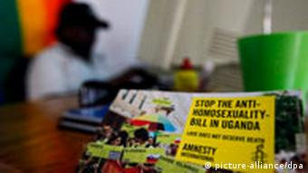 An Amnesty International poster is seen in the foreground as a homosexual rights activist Biggie works on a computer at FARUG (Freedom and Roam Uganda) office in an undisclosed location on the outskirts of Kampala, Uganda's capital, 30 July 2010. FARUG, Uganda's lesbian, bisexual, transgender and intersex human rights group, has been working to push for the full equal rights of the sexual minorities and recognition of the same sex relationship in Uganda since its establishment in 2003. In October 2009, Ugandan parliamentarian David Bahati introduced a bill titled 'Anti-Homosexuality Bill' which if passed would increase and expand the penalties for already-illegal 'homosexual acts' to life imprisonment, or in some cases, the death penalty. EPA/DAI KUROKAWA