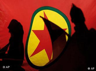 ** FILE ** In this Nov. 12, 2007 file picture, Kurdish demonstrators are silhouetted by a Kurdistan Workers' Party (PKK) flag during a protest in the Cypriot capital of Nicosia. Kurdish rebels have kidnapped three German climbers on Mount Ararat, the governor of a province in eastern Turkey said Wednesday July 9, 2008. (AP Photo/Petros Karadjias)