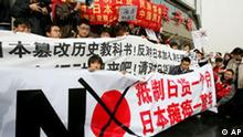 Chinese protestors hold anti-Japanese banners during a rally in Beijing's Haidian district Saturday April 9, 2005. More than 6,000 Chinese protesters held a rally Saturday demanding a boycott of Japanese goods to oppose new textbooks that critics say gloss over Tokyo's wartime atrocities. The slogans on the banners urge a boycott of Japanese goods. (AP Photo/Greg Baker)
