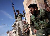 Rebeldes libios luego de la captura y muerte de Gadafi.