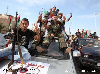 Libyans celebrate the fall of Sirte and death of fugitive former Leader Moammar Gadhafi