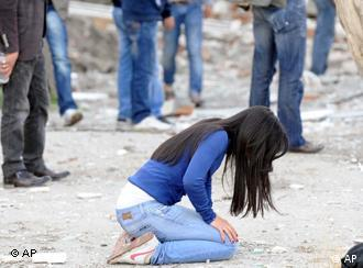 Shocked people seen in the city center of Van after a powerful earthquake struck eastern Turkey Sunday Oct. 23, 2011 , collapsing some buildings and causing a number of deaths, an official said. ( AP Photo/ Abdurrahman Antakyali, Anatolia) TURKEY OUT