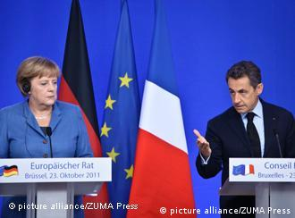 Oct. 23, 2011 - Brussels, BXL, Belgium - German Chancellor Angela Merkel and French president Nicolas Sarkozy give a press briefing during an European Council at the Justus Lipsius building, EU headquarters in Brussels, Belgium on 2011-10-23 Europe aimed to nail down a solution to the worst economic crisis in its history, as the spotlight at an emergency meeting of EU leaders fell on Italy amid contagion fears in the eurozone. The two key players, Germany Chancellor Angela Merkel and French President Nicolas Sarkozy, hailed 'progress' in fighting the crisis as finance ministers thrashed out a framework to protect banks after a marathon session of talks. by Wiktor Dabkowski