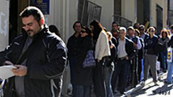 Unemployed Greeks wait in a long line at a state labor office to collect benefit checks, in Athens, on Monday, Oct. 24, 2011. Waiting times were lengthened by a computer system glitch early Monday. Greece, expecting a fourth year of recession in 2012, is suffering from a rapid rise in unemployment _ now at 16.5 percent _ and drop in living standards.