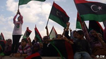 Libyans swing flags at outdoor celebration