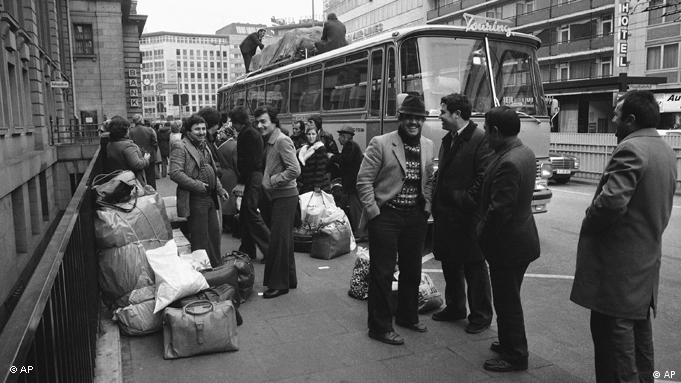 Turkish guest workers wait with luggage for the weekly bus to Istanbul from Frankfurt, Germany around Dec. 2, 1978. (AP Photo/Rolf Boehm)