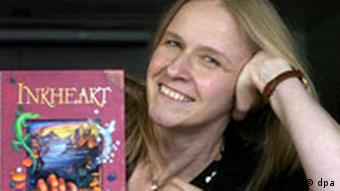 Cornelia Funke poses with a copy of Inkheart