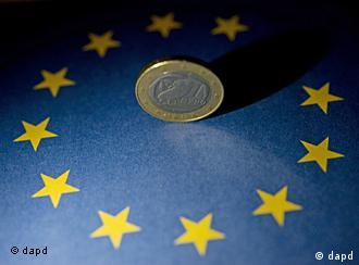 A euro coin on a flag of the EU