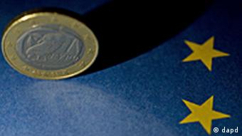 EU flag and euro coin