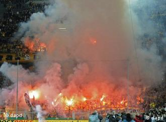 Dresden's supporters set off fireworks during the German Cup soccer match against Dortmund
