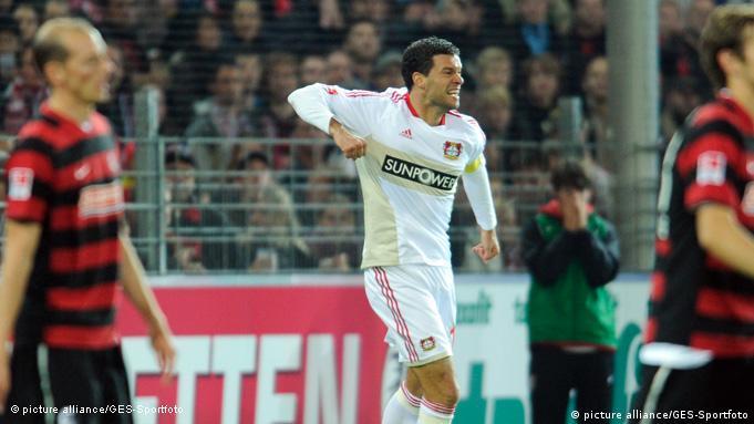 Ballack celebrates after scoring against Freiburg