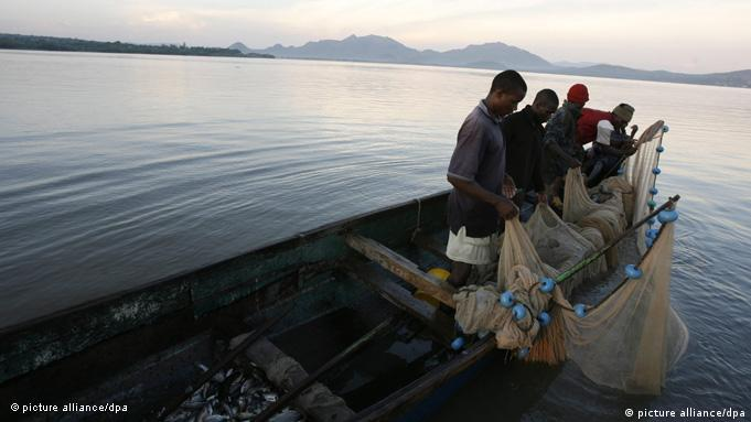 A family of fishermen check their nets in the early morning hours on Lake Victoria