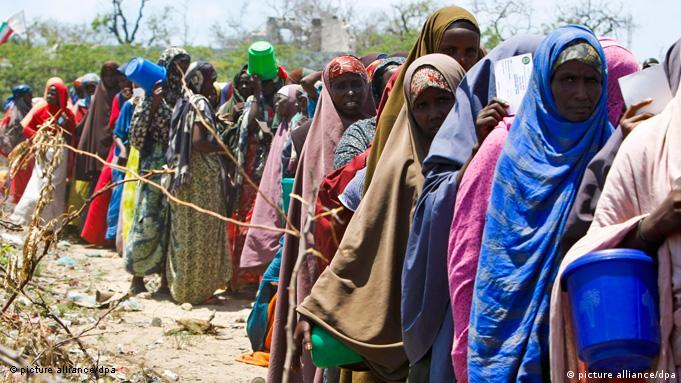 epa02937251 Somali IDPs (Internally Displaced Persons) wait in line to receive relief food at a food distribution center in war-torn Mogadishu, Somalia, 26 September 2011. The country's child mortality rate, which is the highest in the world for children under five, is particularly high in the IDP camps in and around the capital Mogadishu. Although the aid agencies are scaling up the relief effort in preparation for the expected rains in October, the rainy season could kill hundreds each day with water-borne diseases. United Nations refugee agency (UNHCR) says that malnutrition rate had worsened in the last two months, and it will likely to get worse in coming months as no significant harvest is expected for another year. EPA/DAI KUROKAWA