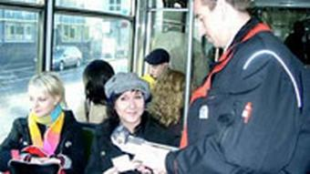 Conductor and passengers in a tram