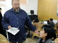 Chinese artist Ai Weiwei, left, speaks to an official, right, from the Beijing Local Taxation Bureau in his home in Beijing on Tuesday Nov. 1, 2011. The outspoken artist said Tuesday that Chinese authorities are demanding he pay $2.4 million in back taxes and fines in a new show of government pressure on the dissident detained for nearly three months earlier this year. (AP Photo/Kyodo News) JAPAN OUT, MANDATORY CREDIT, NO LICENSING IN CHINA, FRANCE, HONG KONG, JAPAN AND SOUTH KOREA