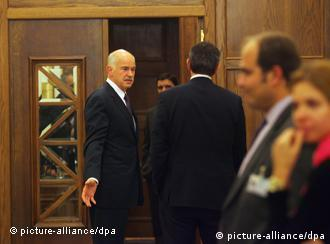 George Papandreou welcomes cabinet ministers to meeting