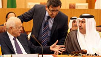 epa02989491 Arab League Secretary General Nabil Alarabi (L) and Qatari Foreign Minister Hamad bin Jasim (R) attend the Arab Foreign Ministers emergency meeting on Syria, at the Arab League Headquarters in Cairo, Egypt, 02 November 2011. According to media reports, Arab foreign ministers are meeting to discuss situation in Syria, amid conflicting reports on reaching an agreement between the Syrian government and the Arab organization. The Arab League has denied receiving a response from Syria to its plan for ending the country's months-long unrest, while the state Syrian News Agency SANA reported late on 01 November that a deal had been reached. EPA/KHALED ELFIQI