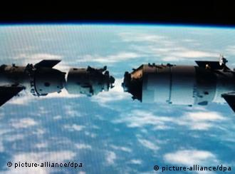 A view of the docking of the Tiangong 1 space lab module and the Shenzhou 8 spacecraft in space