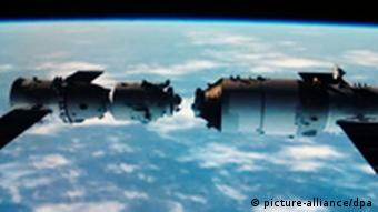 This TV grab taken on 2 November 2011 shows an animated video clip of the docking of the Tiangong-1 space lab module and the Shenzhou VIII (Shenzhou-8) spacecraft in space. China successfully carried out its first docking exercise on Thursday (3 November 2011) between two unmanned spacecraft, a key test of the rising powers plans to secure a long-term manned foothold in space. The Shenzhou-8 spacecraft joined the Tiangong (Heavenly Palace) 1 module about 340 km above Earth, in a maneuver carried live on state television. Photo: Imaginechina