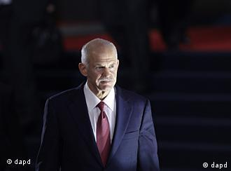 Greek Prime Minister George Papandreou leaves a G20 summit in Cannes, France on Wednesday, Nov. 2, 2011. Greek Prime Minister George Papandreou was flew to the chic French Riviera resort of Cannes on Wednesday to explain himself to European leaders furious over his surprise referendum on a bailout deal that took them months to work out. (AP Photo/Markus Schreiber)