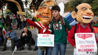Demonstrators wear masks mocking Italian Premier Silvio Berlusconi, right, and Reform Minister Umberto Bossi carrying placards reading: Silvio, change my diaper, left, and I'm looking for confidence, payment in cash during a demonstration staged by the Italian Democratic party in Rome, Saturday, Nov. 5, 2011. The International Monetary Fund will monitor Italy's financial reform efforts, Premier Silvio Berlusconi said Friday, a humbling step for one of the world's biggest _ but also most indebted _ economies as market confidence in its future wanes. Berlusconi told a press conference Friday at the end of the G-20 summit of world leaders in Cannes that Italy had turned down an offer of financial aid from the IMF. We don't believe this type of intervention is necessary, he said. (Foto:Pier Paolo Cito/AP/dapd)