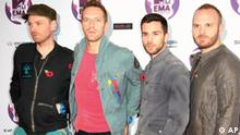 From left, Coldplay members Jonny Buckland, Chris Martin, Guy Berryman, Will Champion pose on the red carpet at the MTV European Music Awards 2011, in Belfast, Northern Ireland Sunday, Nov. 6, 2011. (AP Photo/Joel Ryan)