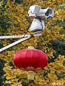 A security camera to watch the main entrance of Chinese dissident artist Ai Weiwei's home is decorated with a Chinese lantern amongst the autumn colors in Beijing, China, Photo:Ng Han Guan/AP/dapd)