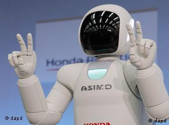 Asimo - Honda Motor Co.'s revamped human-shaped robot Asimo uses a Japanese sign language during a news conference at the Japanese automaker's research facility in Wako, near Tokyo, Tuesday, Nov. 8, 2011 (Photo: Itsuo Inouye/AP/dapd)