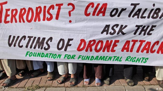 Pakistanis hold a banner during a rally against US drone attacks on Pakistani tribal areas