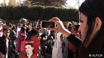 A blogger photographs the demonstrations in Tunis