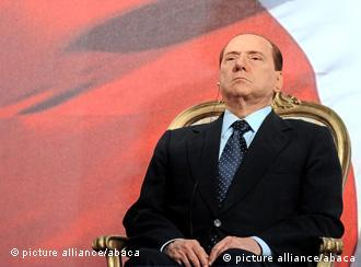 File Photo. Italian Prime Minister Silvio Berlusconi denied reports today that he would resign. Amid the budget crisis, a budget vote is due to take place tomorrow. But according to reports between 20-40 members of Berlusconi's majority may not back the Prime Minister, which could cause the government to fall. Here Italian Prime Minister Silvio Berlusconi is pictured listening as Libyan leader Muammar Gaddafi delivers his speech during a ceremony to mark the Italy-Libya friendship day at the Salvo D'Acquisto Barracks, in Rome, Italy on August 30, 2010. Gaddafi is on an official two-day visit to Italy for talks with Berlusconi. The visit also marks the second anniversary of a friendship treaty between the two countries. Photo by Marco Marianella/Olycom/ABACAUSA.COM
