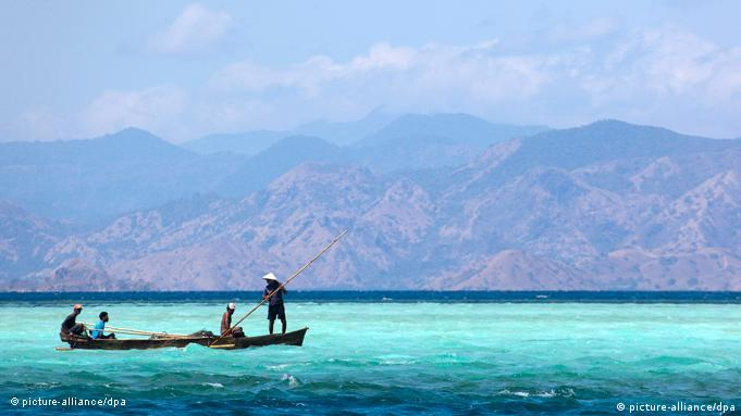 Fishermen in a traditional boat in front of Komodo National Park, Indonesia EPA/OLIVIER MATTHYS