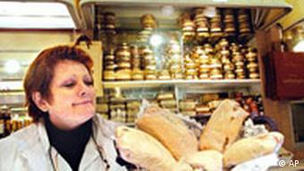 Martine Sanspiche holds pieces of foie gras in Toulouse market, southwestern France, in this Feb.25,2004 photo. French foie gras makers angrily objected to a California bill aimed at banning the sale of the creamy delicacy. The reaction came a day after California Gov. Arnold Schwarzenegger signed a bill that will end the force feeding of ducks, geese and other birds to produce the gourmet liver product by 2012. (AP Photo/Christophe Ena)
