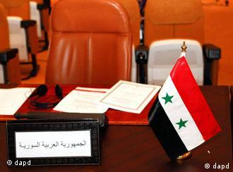 The empty chair of the Syrian delegate is seen at an Arab League foreign ministers meeting