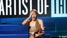 Taylor Swift accepts the award for artist of the year at the 39th Annual American Music Awards on Sunday, Nov. 20, 2011 in Los Angeles. (AP Photo/Matt Sayles)
