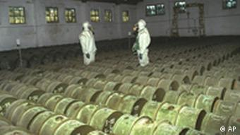 Two Russian soldiers make a routine check of metal containers with toxic agents at a chemical weapons storage site in the town of Gorny, 124 miles (200 kms) south of the Volga River city of Saratov, Russia in this May 20, 2000, photo. Russia plans to start dismantling the world's largest chemical weapons stockpile in 2001, but will need massive Western help to keep up the costly process. (AP Photo)