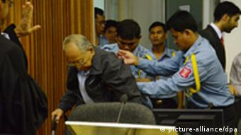 Former Khmer Rouge Deputy Prime Minister Ieng Sary is assisted in the court room during a public hearing at the (ECCC), in Phnom Penh, Cambodia, 21 November 2011. (Photo: EPA/NHET SOK HENG / ECCC HANDOUT)