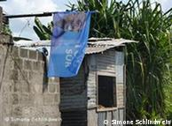 Ramshackle building with campaign flag in Congo