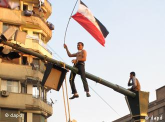 An Egyptian protester hangs an effigy representing Egypt's military ruler, Field Marshal Mohamed Hussein Tantawi